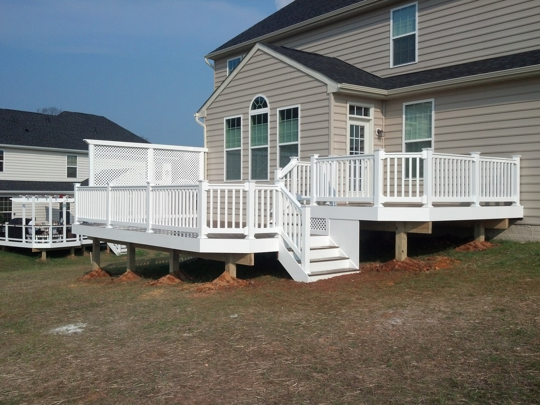 Harford County Maryland Multi-Level Maintenance Free Evergrain Deck with White Vinyl Railings and Lattice Privacy Screen.
