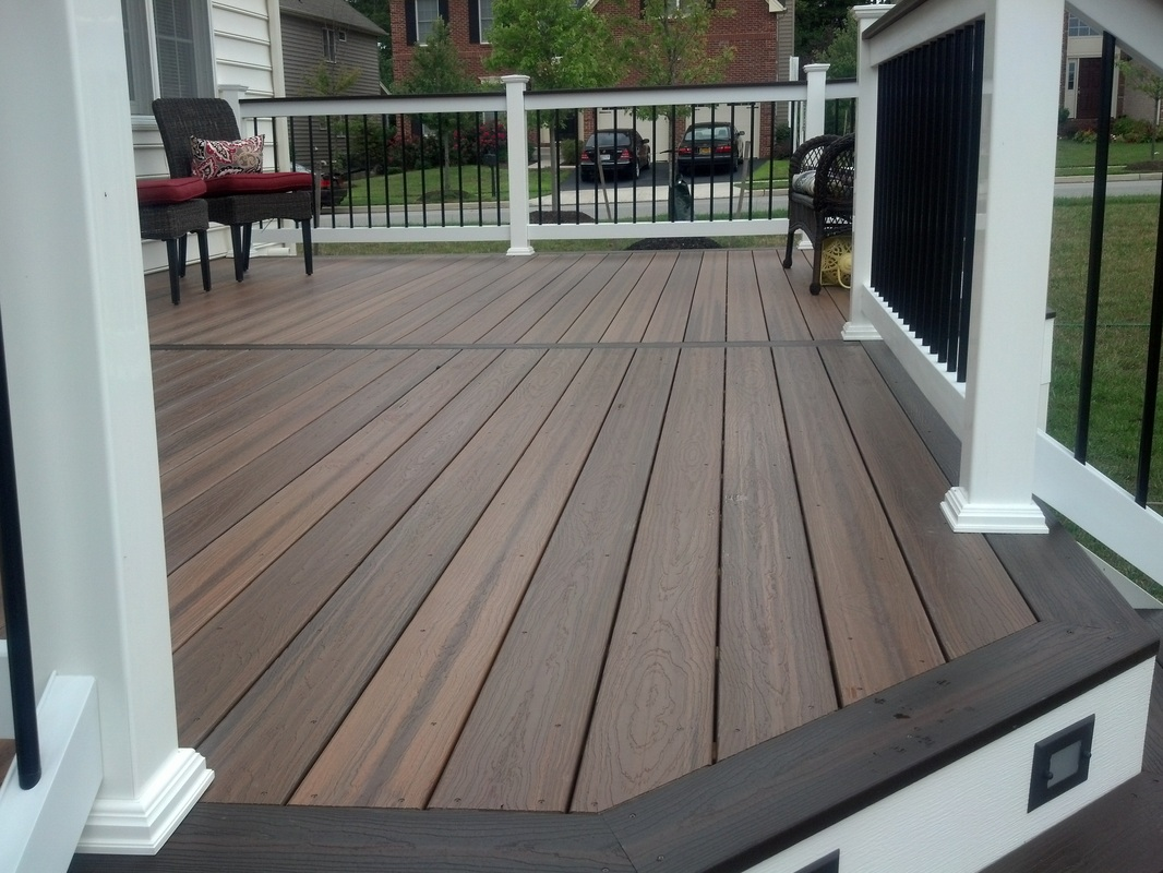 Harford County Maryland Evergrain Envisions Spiced Teak Decking with Rustic Walnut Picture Framing.