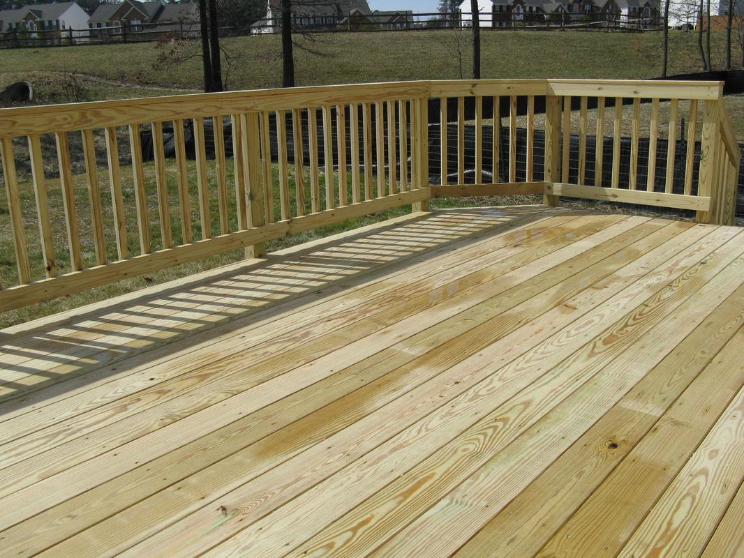 Harford County Maryland Pressure-Treated Pine Wood Decking with Colonial Sweep Railings.